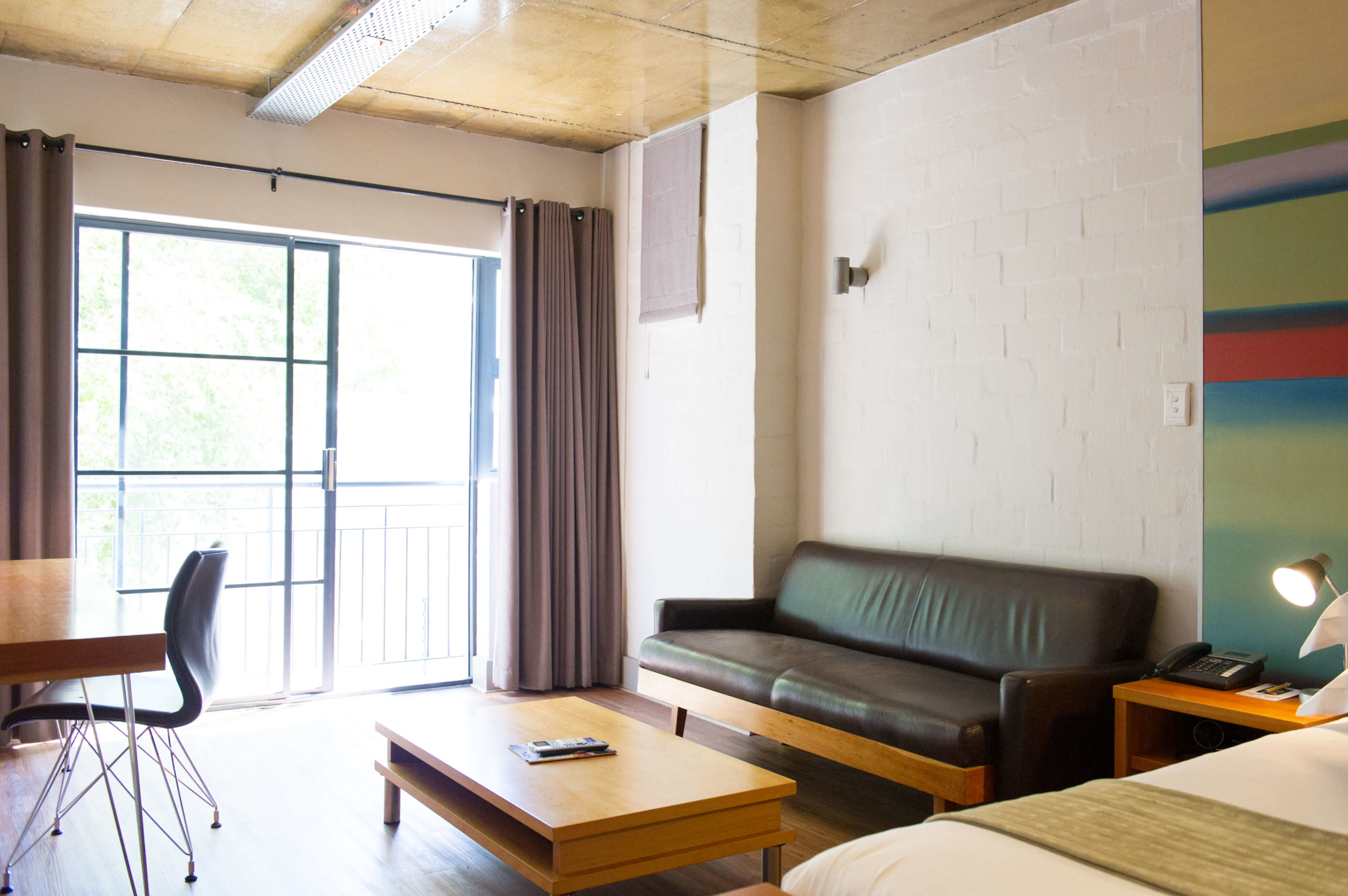 Lounge with leather couch at Hippo Boutique Hotel